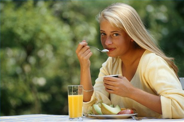 picture of woman enjoying ant-candida diet